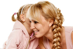 Whispering daughter and mother Royalty Free Stock Photo