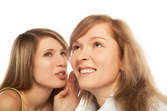 Whispering girls Royalty Free Stock Images