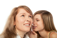 Whispering girls Stock Images