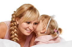 Whispering little girl and mother Royalty Free Stock Images