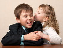 Whispering secrets in the classroom Stock Image
