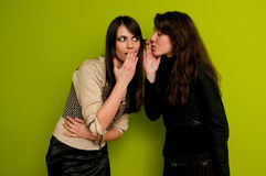 Whispering secrets and gossip Stock Photos