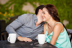 Whispering something to her date Stock Image