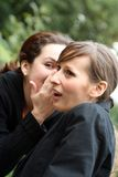 Whispering women Royalty Free Stock Images