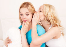 Whispering women Stock Images