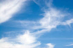 Whispy Blue Clouds Stock Images