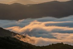 Whispy Clouds Cling to the Blue Ridge Mountains stock images