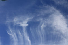 Whispy Clouds Dark Blue Sky Background Royalty Free Stock Photo