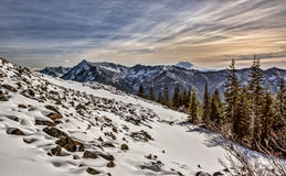Rocky Snow Field in Cascade Mountain Range. View of Mount Rainier from atop Mailbox Peak and Snow Covered Rock and Boulder Field Royalty Free Stock Image