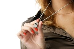 Whistle. Silver whistle in woman hand with orange nails. Focused on hand. Isolated over white with large area for your text stock photo