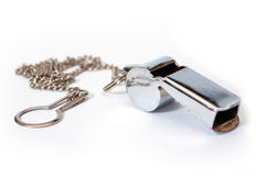 Whistle. Metal whistle with chain to hang up Royalty Free Stock Photo