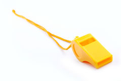 Whistle. Yellow whistle on isolated background Royalty Free Stock Photography