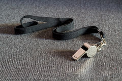 Whistle with a Black Strap. On the Tissue Surface Stock Photography
