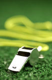 Whistle laying on green astroturf. Close up of whistle laying on green astroturf Royalty Free Stock Photography