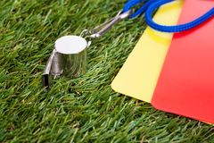 Whistle With Red And Yellow Card On The Field Stock Photos