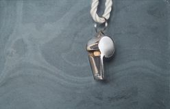 Whistle of a soccer referee Stock Images