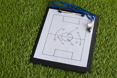 Whistle and soccer tactic diagram on paper Stock Images
