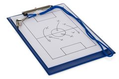 Whistle and soccer tactic diagram on paper Royalty Free Stock Image