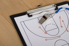 Whistle and sport tactics on paper. Close-up Of Clipboard With Whistle And Sport Tactics On Paper Royalty Free Stock Images