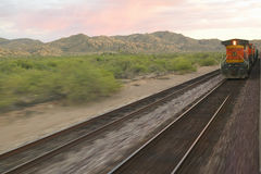 Whistle Stop Kerry Express across America train moving through landscape, American Southwest Royalty Free Stock Photography