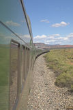 Whistle Stop Kerry Express across America train moving through landscape, American Southwest Royalty Free Stock Photo