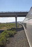 Whistle Stop Kerry Express across America train moving through landscape, American Southwest Royalty Free Stock Photos