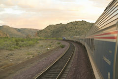 Whistle Stop Kerry Express across America train moving through landscape, American Southwest Royalty Free Stock Image