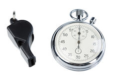 Whistle and stopwatch. Isolated on white. Clipping paths Stock Photography