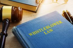 Whistleblower law on a desk. Whistleblower law on a court desk Royalty Free Stock Photos