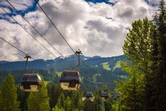 Cableway gondola in Whistler Village. WHISTLER, BRITISH COLUMBIA, CANADA - JULY 2, 2017 : Cableway gondola in Whistler Village. Whistler is a canadian resort Stock Photo