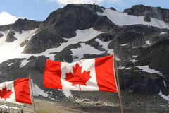Whistler Mountain. Canadian Flag in the Whistler Mountains, BC Stock Photo