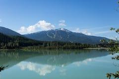 Whistler Over Lake. Popular ski mountain at Whistler over a beautiful lake Stock Photo