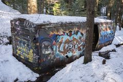 Whistler Train wreck site with grafitti painted rail car. 60 year old wrecked graffiti covered rail car is nestled among forest trees at the Whistler train wreck royalty free stock image