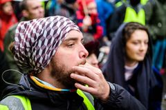 Whistling at Marche Pour Le Climat march protest on French stree stock photography