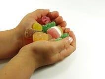 Whit van handen suikergoed Royalty-vrije Stock Foto's