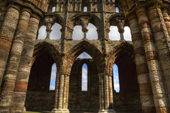 Whitby Abbey. Gothic Arches of ruins of  Benedictine abbey overlooking the North Sea in Whitby, North Yorkshire Royalty Free Stock Photography