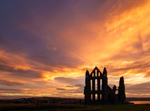 Whitby Abbey against a dramatic sunset. Royalty Free Stock Photography