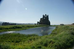 Whitby abbey, north yorkshire, Benedictine abbey. Whitby abbey, cliff top Benedictine abbey. Whitby north yorkshire coastline, fishing port Stock Photo