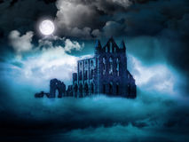 Whitby Abbey, North Yorkshire Coast, UK. Illustrated photograph of Whitby Abbey - a foggy night by moonlight Royalty Free Stock Images