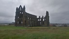 Whitby Abbey on an overcast day. Scenic ruins of Whitby Abbey on an overcast day. North Yorkshire Stock Image