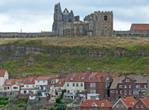 Whitby Abbey overlooking the town. Historical Whitby Abbey,  England overlooking the town below Stock Images