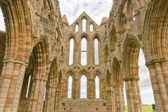 Whitby abbey ruin, yorkshire, uk. Interior of Whitby Abbey ruin in Yorkshire, famous for providing inspiration for Bram Stoker`s Dracula on an overcast day in Stock Image