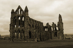 Whitby Abbey in Sepia. Whitby Abbey (of Dracula fame) and overlooking the rooftops of Whitby, Yorkshire, UK Stock Image