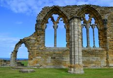 Whitby Abbey. Was a 7th century Christian monastery that later became a Benedictine abbey The abbey and its possessions were confiscated by the crown during the Stock Photos
