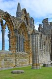 Whitby Abbey. Was a 7th century Christian monastery that later became a Benedictine abbey The abbey and its possessions were confiscated by the crown during the Stock Photo