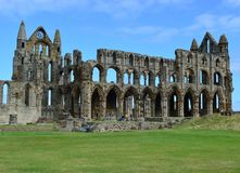 Whitby Abbey. Was a 7th century Christian monastery that later became a Benedictine abbey The abbey and its possessions were confiscated by the crown during the Royalty Free Stock Image