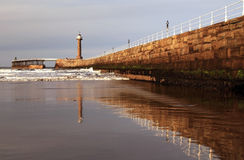 Whitby Bay Harbor Wall and Light House Royalty Free Stock Photos