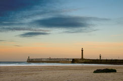 Whitby beach and pier Stock Images