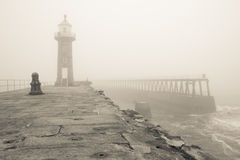 Whitby East pier and Lighthouse in thick fog Royalty Free Stock Image