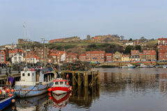 Whitby fishing port and ruined abbey. Whitby is an attractive seaside town and a popular tourist destination, partly because of its association with Bram Stock Photos